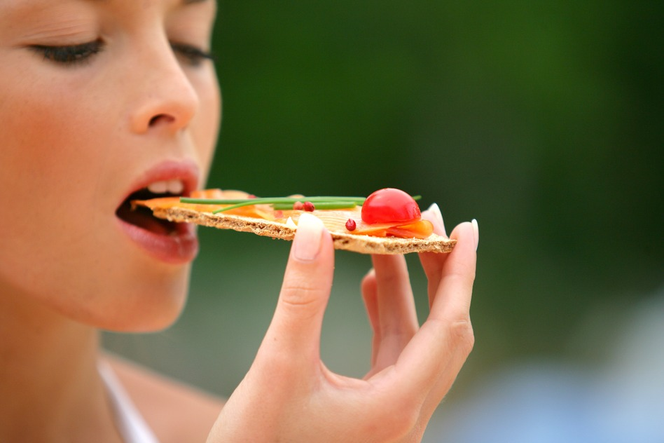 Woman eating healthy cracker snack
